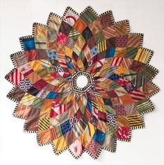Kaleidoscope Christmas Tree Skirt made from mens' vintage ties.  Saw where this was a fundraiser for Chicago Lost and Found.  They were selling for $1200 apiece!  How meaningful, to use old ties from the men in your family and diy!  (Haven't found a Kaleidoscope Tree Skirt pattern that looks the same, however.)