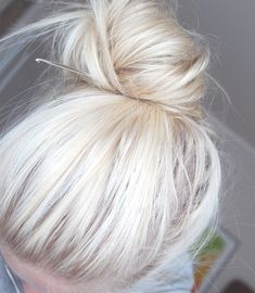 I love this bun...I'm not sure why there's a crochet hook in it....but I love the volume and shape. So much cuter than the same old sock bun! :)