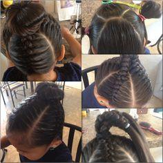 Cute little girl hair style. Braids and a bun on top.