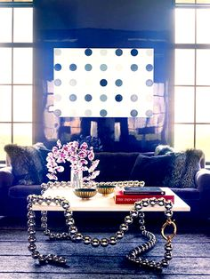 6 Things Every Stylish Person Has At Home//necklace table, Damien Hirst, lacquered walls, fur pillows, orchids, coffee table styling