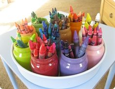 What a lovely system for organizing the crayons. It makes an attractive centerpiece while they're coloring. And putting the supplies away becomes a game. Simply done with painted baby food jars.