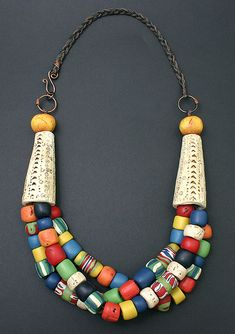 Designed by Dorothy Siemens | Necklace combining Faux Bone (polymer clay) and antique Trade beads