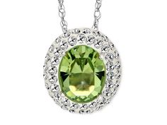 6/6/14 - Go gaga for green! This dazzling pendant features a stunning oval meadow Swarovski crystal surrounded by shimmering white Swarovski crystal delicately set in sleek sterling silver. Comes with an 18-inch sterling silver rope chain.