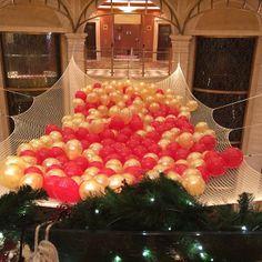 A Christmas balloon drop takes Atrium celebration to a whole new level!