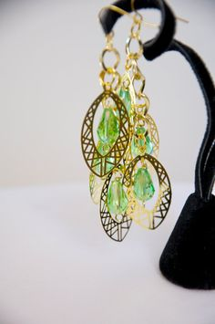 Stunning Gold Dangle Earrings with Green Teardrop Crystals