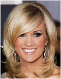 Thick, blonde hair looks great on Carrie Underwood! Learn insider secrets on how to get thick hair by simply clicking on the photo.