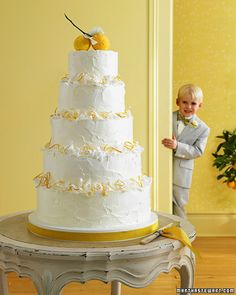 Meyer Lemon Wedding Cake composed of layers of Meyer lemon-flavored cake, lemon curd, and coconut Swiss-meringue buttercream. Curls of fresh coconut and candied lemon peel form the ruffled flounces on the tiers. From www.marthastewartweddings.com.