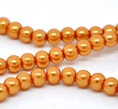 pumpkin orange pearls as a Halloween Wedding accessory.