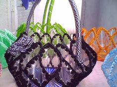 from plastic bottle and CD, crocheted around plastic bottles with tiny hole punches