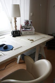 Old door desk for dining room so other table can be used for laundry
