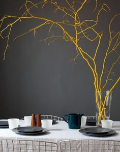 Painted twigs- love yellow and charcoal together