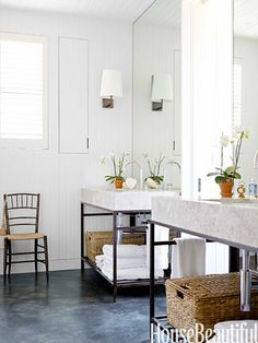 Blocks of Calacatta Crema marble top the steel vanities in the master bathroom.