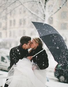 Snowy kiss. AFTER your wedding, go out and take a fun photo session; in the rain, the snow, on the beach, in and around water-ponds swimming pools-railroad tracks, old abandoned homes or buildings.Have FUN and just go with it  :)