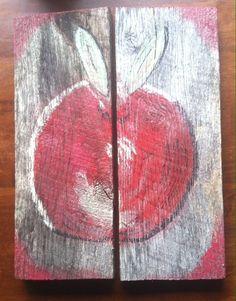 Apple on fence board