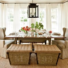 Dress a room in white linen. Flowy draperies frame the dining room's three sides of windows to soften the space. A continuous curtain rod keeps the look                                         unfussy.