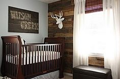 I Love the Rustic Accent wall...believe it or not it's made from old Pallets!