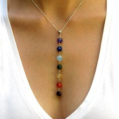 Gemstone Chakra Pendant Necklace: Within your body, it's believed that seven energy centers, or chakras, run along your spine, and doing certain yoga poses can stimulate and balance the energy within them. Each chakra is represented by a colored stone in this Gemstone Chakra Pendant Necklace ($30).