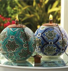 Illuminate your evenings outdoors with a hand-painted ceramic work of art, the Bella Tabletop Torch.