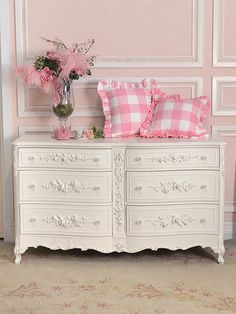 Gorgeously feminine, vintage inspired decor of the sort that I would gleefully deck my whole house out in. #vintage #pink #dresser #home #decor #shabby #chic #pillows #cushions #girly