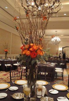 Wedding reception flowers, Wedding centerepieces in orange, elevated centerepieces, Curly willow branches