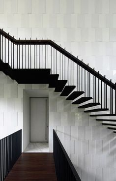 BLACK & WHITE HOUSE BY FORMWERKZ ARCHITECTS -- I really like the way the shadows from the staircase accentuate the pattern on the wall behind it.