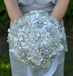 DANG!!! This makes me want to remarry my husband!!! A rhinestone jewel brooch bridal bouquet made by Noaki on Etsy.