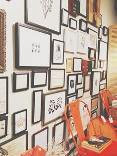 Gallery wall, orange tolix style chair