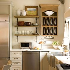 Open shelving, country kitchen... yes, please.  neutral colors for walls and shelves... and bright colored dishes!