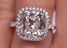Cushion cut diamond ring with pave halo setting