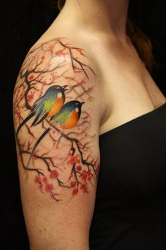 pari tattoo, colorful birds, bird tattoos, watercolor tattoos, tattoo artists, blossom trees, tattoo patterns, cherry blossom tattoos, cherry blossoms
