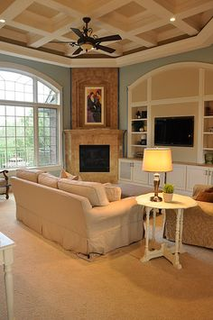 Coffered ceiling with aqua walls. This living room is beautiful! PLUS I love that the fireplace is off to the side!!!