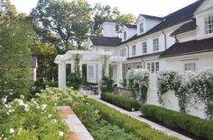 white flowers & greenery with pretty white home