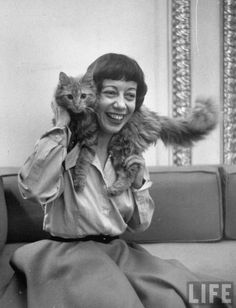 Comedienne Imogene Coca draping her cat around her neck. Alfred Eisenstaedt, New York City, 1951. Source: LIFE Photo Archive, hosted by Google.