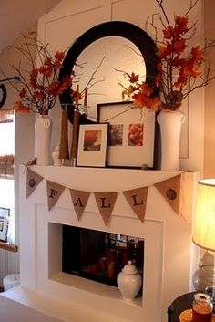 beautiful fall mantels, change the two front pictures with every season, snowflakes for winter, sand dollars and starfish for summer. Could change the colour of the flowers to match the season too.
