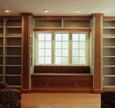 Home Library with Window Seat - I like how there are small shelves on the divider walls to either side of the window seat.