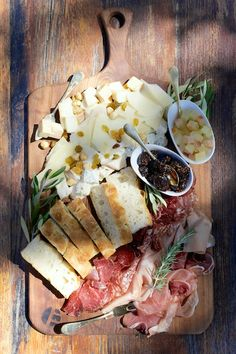Rustic cheese & meat platter on on a wooden board