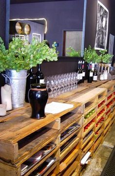 Rustic shelving made from recycled pallets... Pretty cool idea for a bar on the porch...