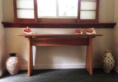 Modern Designer Sofa Table with Subtle Beach Decor.