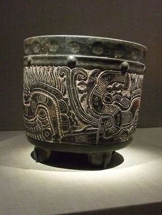 Carved tetrapod vase with serpent Central Maya area Early Classic Period 250-550 CE Earthenware