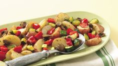 Quickly toss potatoes, peppers and zucchini in seasoned oil and bake for a 30-minute side dish.