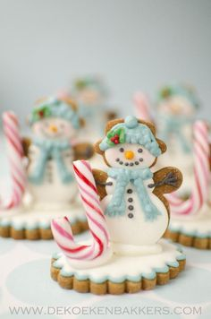 Snowman cookie idea. Love the candy cane!