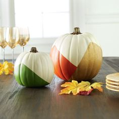 Add a bit of DIY color blocking to your fall home decor. These adorable fall painted color block pumpkins are a perfect addition to any home, porch, or patio.