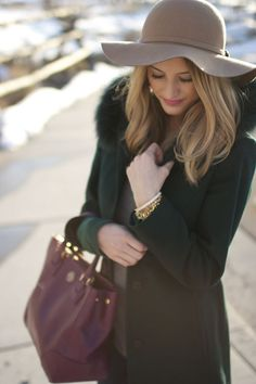 green coat and violet bag