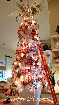 Kitchen island tree with an AnnaLee elf climbing on it. My Mother has always had an obsession with anything AnnaLee so they hold some special memories in my heart as well because of her!