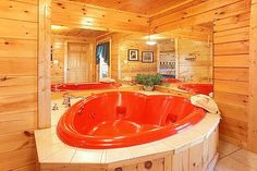 Hideaway Heart cabin rental near Pigeon Forge, TN. With its massive log bed and heart shaped Jacuzzi, this cabin is the perfect hideaway for two. Snuggle in front of the fire, get cozy in the hot tub on the deck, and in warmer months you can take a dip in the swimming pool. Take a trip to the mountains today!