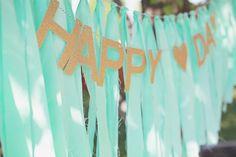 DIY fabric strip banner on baker's twine {1.5 wide x 1 yard long, then folded in half} + glitter word garland  {Dear Lizzy}