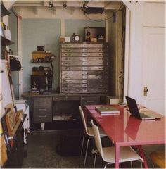 Industrial office space with hot pink table