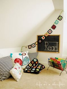 crocheted bunting and chalkboard in a reading nook