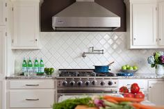 Backsplash tile.  White Kitchen, with Bianco Antico Granite contemporary kitchen