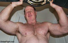 pro wrestler holding championship belt